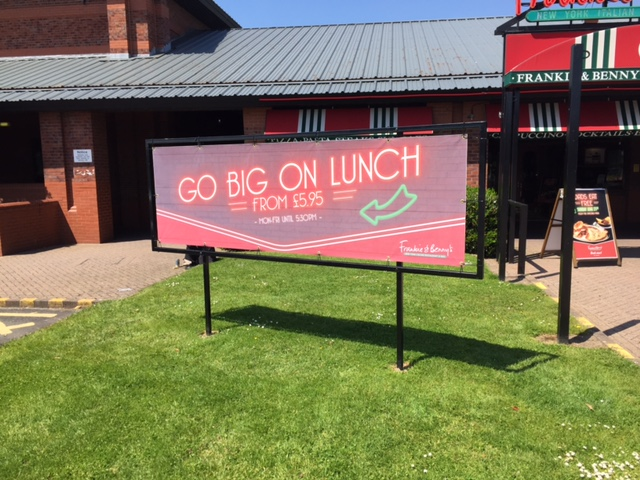 Frankie and Bennys banner in frame all supplied by ourselves